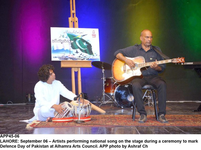 LAHORE: September 06 – Artists performing national song on the stage during a ceremony to mark Defence Day of Pakistan at Alhamra Arts Council. APP photo by Ashraf Ch
