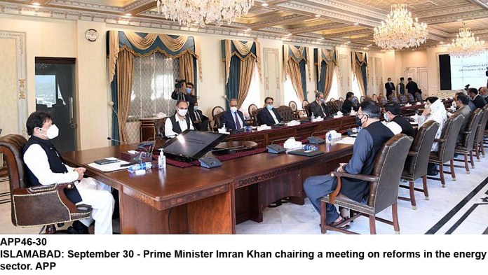 ISLAMABAD: September 30 - Prime Minister Imran Khan chairing a meeting on reforms in the energy sector. APP