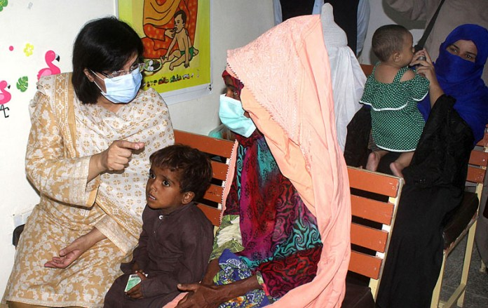 JAMPUR: September 11 - Special Assistant to the Prime Minister on Social Protection and Poverty Alleviation, Dr. Sania Nishtar talking to the woman during her visit to Ehsaas Nashonuma Center. APP photo by Tanveer Bukhari