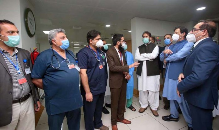 PESHAWAR: September 28 - Prime Minister Imran Khan receives briefing on new Surgical Block at Lady Reading Hospital. APP