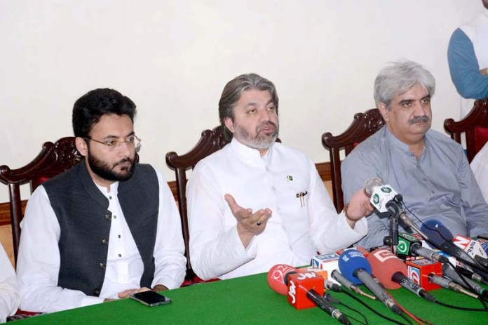 FAISALABAD: September 07 - Federal Minister for Parliamentary Affairs, Ali Muhammad Khan addressing a press conference along with Parliamentary Secretary for Railway, Farrukh Habib and MNA Faiz ullah Kamoka at Circuit House. APP photo by Tasawar Abbas