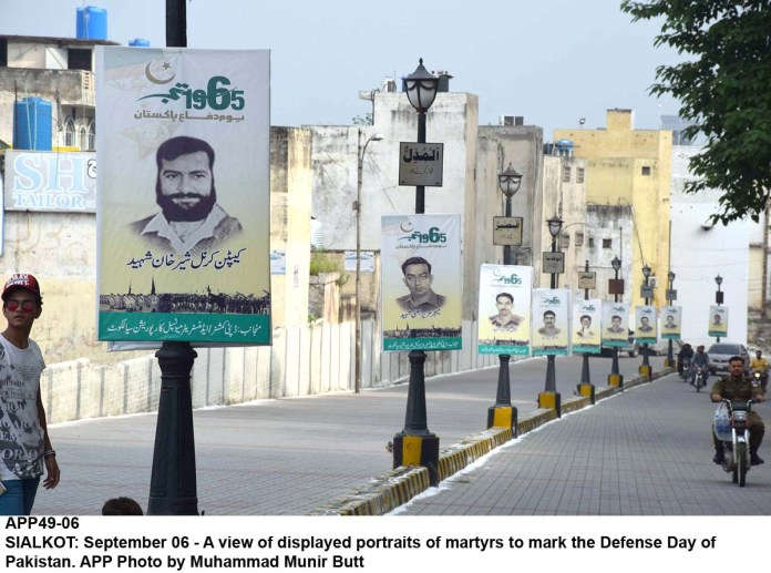 SIALKOT: September 06 - A view of displayed portraits of martyrs to mark the Defense Day of Pakistan. APP Photo by Muhammad Munir Butt