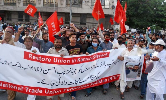 KARACHI: September 28 - Members of National Trade Union Federation Pakistan (NTUFP) are holding protest demonstration for acceptance of their demands, at Karachi press club. APP photo by Syed Abbas Mehdi