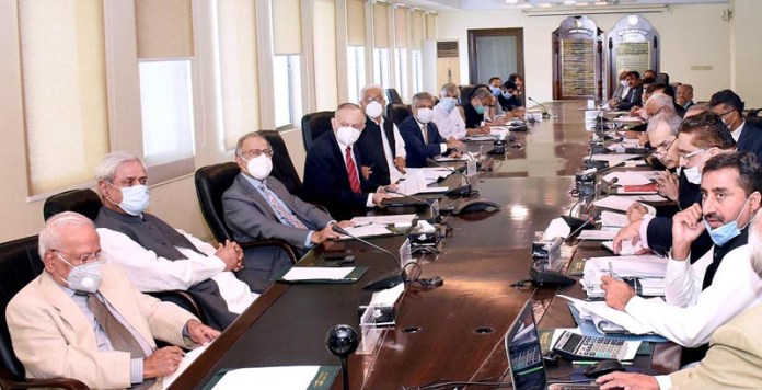 ISLAMABAD: October 12 - Adviser To The Prime Minister On Finance And Revenue, Dr. Abdul Hafeez Shaikh chairing a meeting of the National Price Monitoring Committee (NPMC) to Curb Inflation. APP