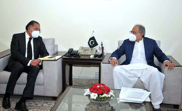 ISLAMABAD; October 23 - Adviser to PM on Finance Dr. Abdul Hafeez Shaikh in a meeting with Ambassador Munir Akram, Pakistan Permanent Representative to UN. APP photo by Saeed-ul-Mulk