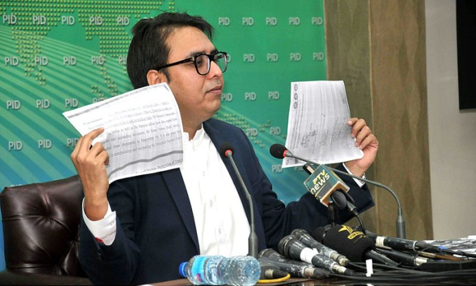 ISLAMABAD: October 24 - Special Assistant to Prime Minister on Political Communication Dr. Shahbaz Gill addressing a press conference at PID Media Center. APP photo by Saeed-ul-Mulk
