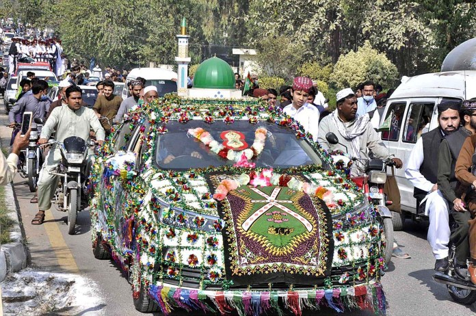 ISLAMABAD: October 30 - A large number of people participating in Eid Milad-un-Nabi (PBUH) procession to celebrate birthday of Holy Prophet Muhammad (Peace Be Upon Him). APP photo by Saleem Rana