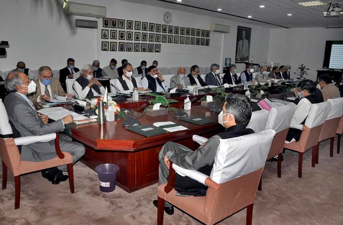 ISLAMABAD: October 07 - Advisor to Prime Minister on Finance and Revenue, Dr. Abdul Hafeez Shaikh chairing ECC meeting at Cabinet Division. APP photo by Saleem Rana