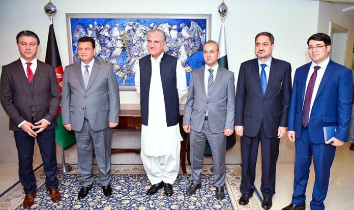 ISLAMABAD: October 24 - A group photo of Afghan delegation led by Speaker Wolesi Jirga Rehman Rahmani with Foreign Minister Makhdoom Shah Mahmood Qureshi at Ministry of Foreign Affairs. APP