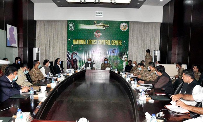 ISLAMABAD: October 02 - Federal Minister for National Food Security and Research Syed Fakhar Imam chairing a meeting on locusts at National Locusts Control Centre. APP photo by Saleem Rana