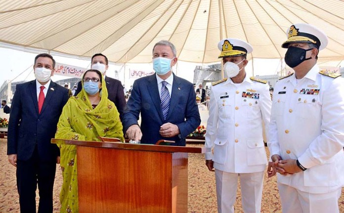 KARACHI: October 25 - Minister of National Defence of the Republic of Turkey, HulusiAkar performing the Keel Laying of MILGEM Class Corvettes being built at Karachi Shipyard &Engg. Works (KS&EW) for Pak Navy. APP Photo M. Saeed Qureshi