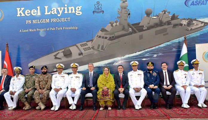 KARACHI: October 25 - A group photo of Minister of National Defence of the Republic of Turkey, HulusiAkar, Chief of the Naval Staff, Admiral Muhammad Amjad Khan Niazi NI(M), Minister for Defence Production Zobaida Jalal, MD KS&EW, Rear Admiral Ather Saleem HI(M) and officers of the project at Keel Laying of MILGEM Class Corvettes. APP Photo M. Saeed Qureshi