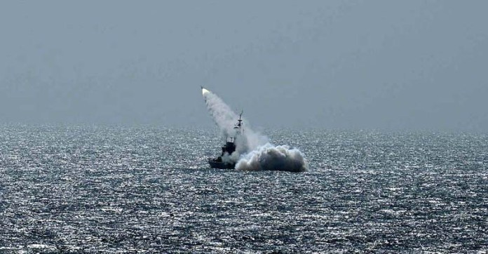 KARACHI: October 28 - Pakistan Navy helicopter conducting live missile firing at North Arabian Sea. APP