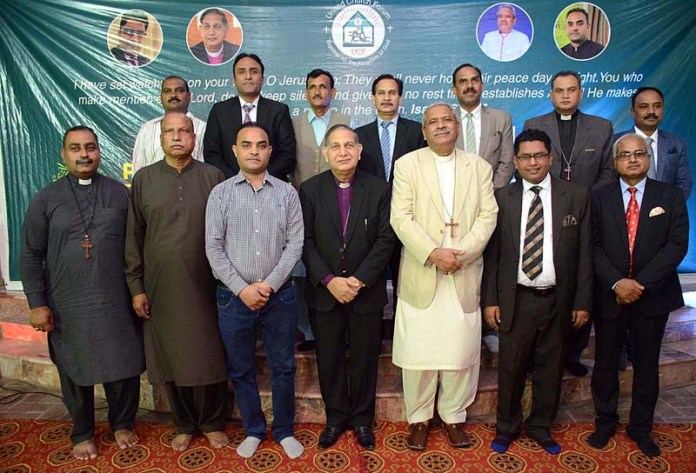 PESHAWAR: October 09 – Moderator Church of Pakistan Bishop Humphrey S. Peters in a group photo with newly elected United Church Forum office bearers. APP Photo by Shaheryar Anjum