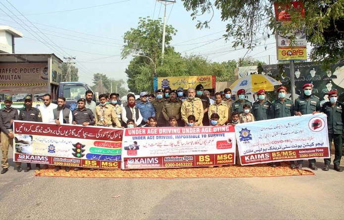 MULTAN: October 23 - Chief Traffic Officer Zafar Buzdar leading awareness walk organized by City Traffic Police. APP photo by Tanveer Bukhari