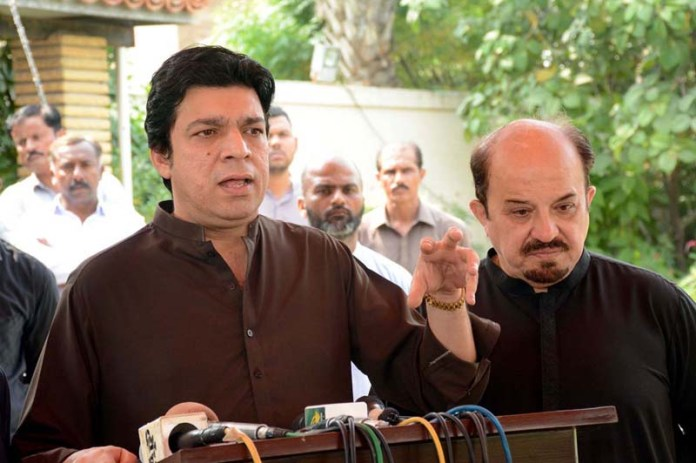 KARACHI: October 18 - Federal Minister for Water Resources Faisal Vawda addressing a press conference. APP photo by M Saeed Qureshi