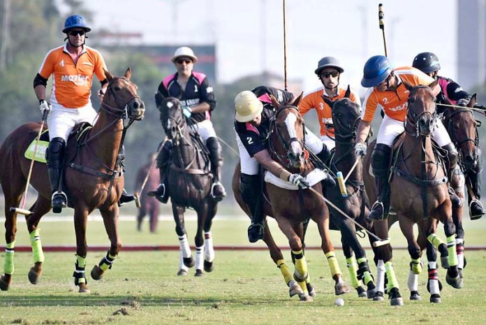 LAHORE: October 27 - Players struggling to get hold on the ball during polo match played between Master Paints FG Polo and Platinum Home Guard Group Polo teams at Lahore Polo Club during Shaukat Khanum Pink Polo Cup 2020. Platinum Home Guard Group won by 10.5-6. APP Photo by Mustafa Lashari