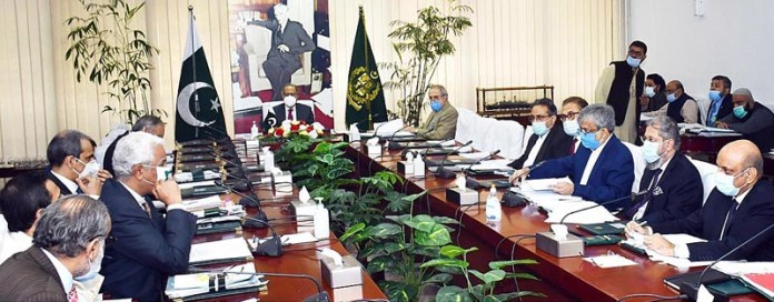 ISLAMABAD: October 02 - Adviser to the Prime Minister on Finance and Revenue, Dr. Abdul Hafeez Shaikh chairing a meeting of the Economic Coordination Committee (ECC) of the cabinet. APP
