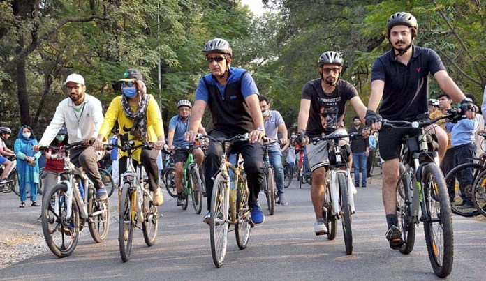 "ISLAMABAD: October - 24 - Special Assistant to PM on Climate Change Malik Amin Aslam Khan leading a cycle rally titled ""Cycle for Green Pakistan"" at Rose and Jasmine Garden. APP photo by Saeed-ul-Mulk"