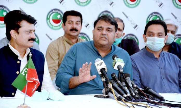 KARACHI: October 04 - Federal Minister for Science and Technology Fawad Chaudhry addressing a press conference at Insaf house in Provincial Capital. APP photo by M Saeed Qureshi