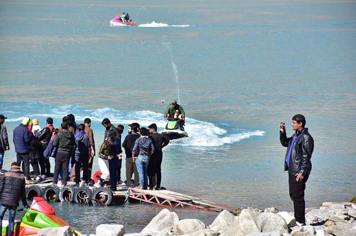 ATTABAD: October 27 – People enjoying boat ride in Attabad Lake during their visit. APP photo by Irshad Sheikh