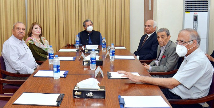KARACHI: October 14 - Federal Minister for Education Shafqat Mehmood chairing a meeting with Chairman NAPA Tariq Kirmani and members of Board of Directors at National Academy of Performing Arts. APP Photo by Saeed Qureshi