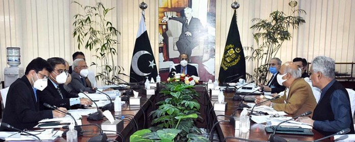 ISLAMABAD: October 01 - Adviser to the Prime Minister on Finance and Revenue, Dr. Abdul Hafeez Shaikh chairing a meeting of the Executive Council of the National Economic Council (ECNEC) in 2020. APP