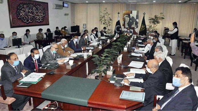 ISLAMABAD: October 14 - Adviser to the Prime Minister on Finance, Dr. Abdul Hafeez Shaikh chairing a meeting of the Economic Coordination Committee (ECC) of the Cabinet. APP photo by Saleem Rana