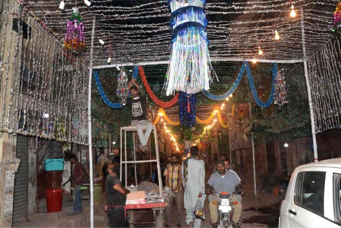 LAHORE: October 29 - People decorating street with colorful lights in connection with Eid-Milad un Nabi (PBUH). APP photo by Ashraf Ch