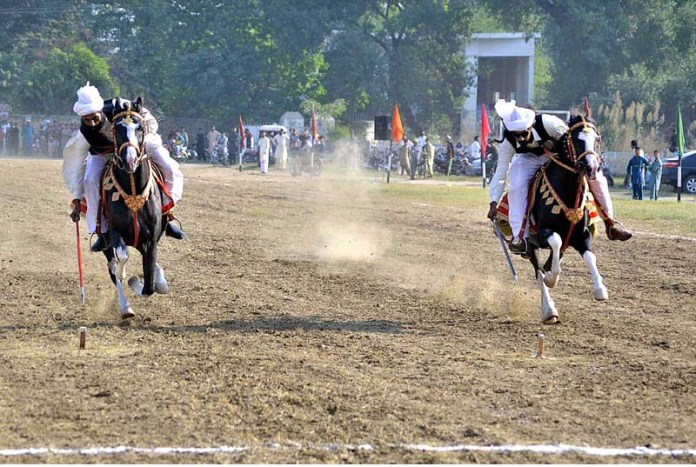 ATTOCK: October 18 - Players participating in tent pegging competition at Quaid-e-Azam Stadium. APP photo by Ghulam Shabbir