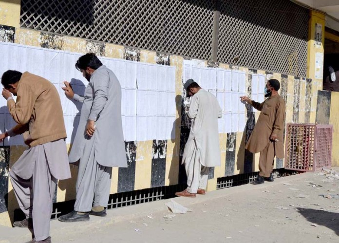 QUETTA: October 19 - Appeared candidates are looking their names in displaying lists at Secretariat Office. APP photo by Mohsin Naseer