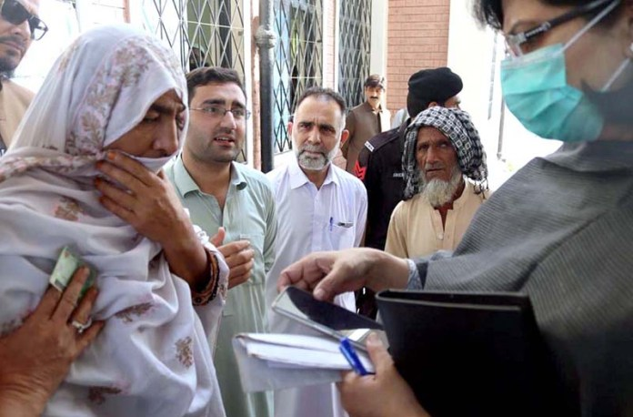 CHARSADA: October 10 - SAPM Poverty Alleviation, Dr. Sania Nishtar reviews Ehsaas registration desks in Charsadda, interacts with applicant men and women. APP