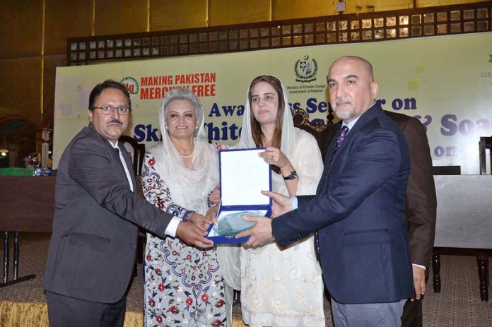 LAHORE: October 29 - Minister of State For Climate Change Zartaj Gul addressing an Awareness Seminar on skin whitening creams and soaps at local hotel. APP photo by Amir Khan