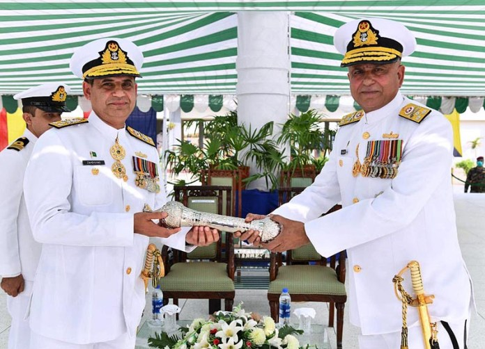 ISLAMABAD: October19 - Vice Admiral Zahid Ilyas handing over Command Scroll to incoming Commander Karachi Vice Admiral Faisal Rasul Lodhi. APP