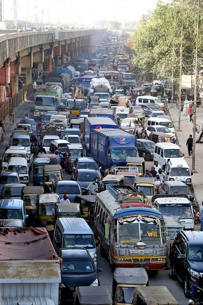 KARACHI: October 03 - A view of massive traffic jams at Liaquatabad area and need the attention of concerned authorities. APP photo by Syed Abbas Mehdi