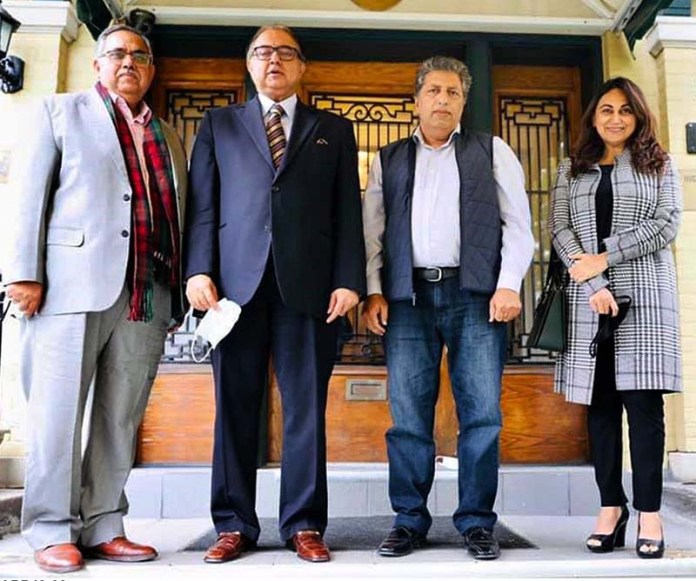 OTTAWA: October 09 – High Commissioner for Pakistan to Canada Mr. Raza Bashir Tarar snapped with Mubin Ahmad, a Pakistani businessman from Edmonton, Alberta, and Mr. Atta ur Rehman Syed and Mrs. Sadaf Ibrahim, President Canada Pakistan Association, National Capital Region following their meeting, outside the High Commission for Pakistan building. APP