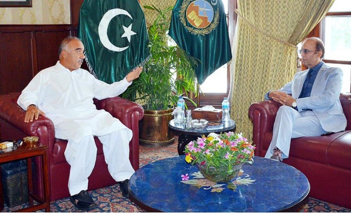 PESHAWAR: October 06 - Governor Khyber Pakhtunkhwa Shah Farman talking with Accountant General Khyber Pakhtunkhwa Shahid Nadeem who called on him at Governor's House. APP