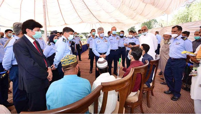 RAWALPINDI: October 20 - Air Marshal Muhammad Haseeb Paracha, Deputy Chief of the Air Staff (Support) Pakistan Air Force interacting with the persons with special needs during International White Cane Safety Seminar at PAF Base Nur Khan. APP
