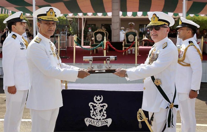 ISLAMABAD: October 07 - Admiral Zafar Mahmood Abbasi handing over the command scroll of Pakistan Navy to Admiral Muhammad Amjad Khan Niazi during Change of Command ceremony. APP