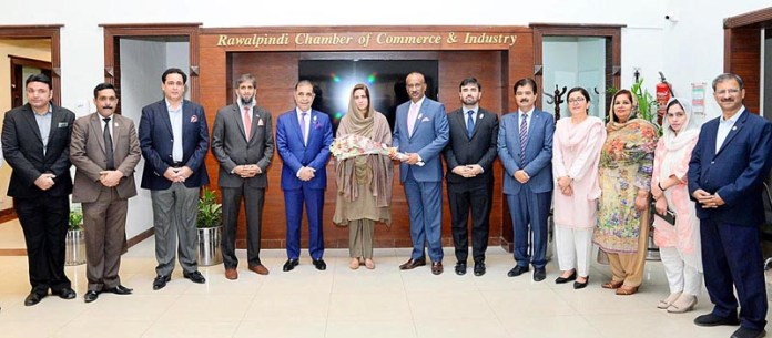 RAWALPINDI: October 26 – Minister of State for Climate Change Zartaj Gul being presented flower bouquet by Present Rawalpindi Chamber of Commerce Nasir Mirza during her visit the chamber. APP photo by Abid Zia