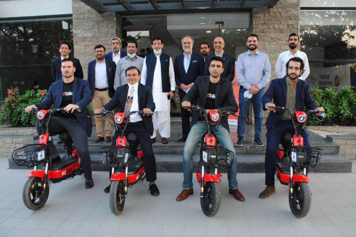 ISLAMABAD: October 14 - Federal Minister for IT and Telecommunication Syed Amin Ul Haque in a group photo during the launching ceremony of Ezbike at National Incubation Center. APP photo by Irshad Sheikh
