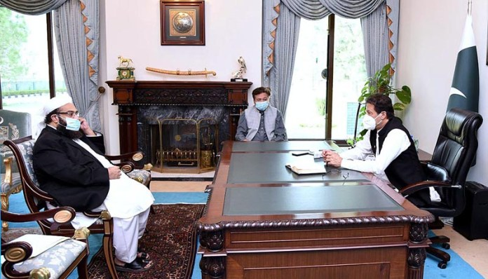 ISLAMABAD: October 21 - Maulana Tahir Mehmood Ashrafi, Special Representative of the Prime Minister on Religious Harmony called on Prime Minister Imran Khan. APP