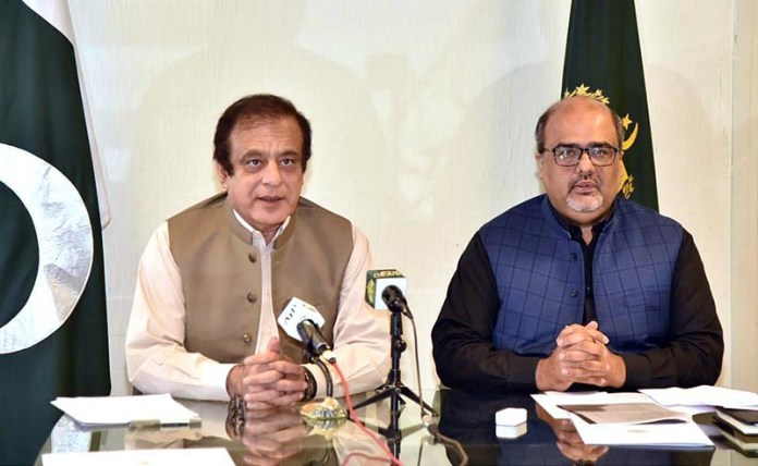 ISLAMABAD: October 22 - Senator Shibli Faraz, Federal Minister for Information and Broadcasting and Shahzad Akbar, Advisor to PM on Accountability & Interior talking to media. APP
