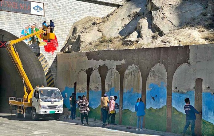 GILGIT: October 22 - District administration busy in removal of wall chalking and beautification of tunnels in sub Division Gojal Hunza. APP Photo by Ashraf Hussain