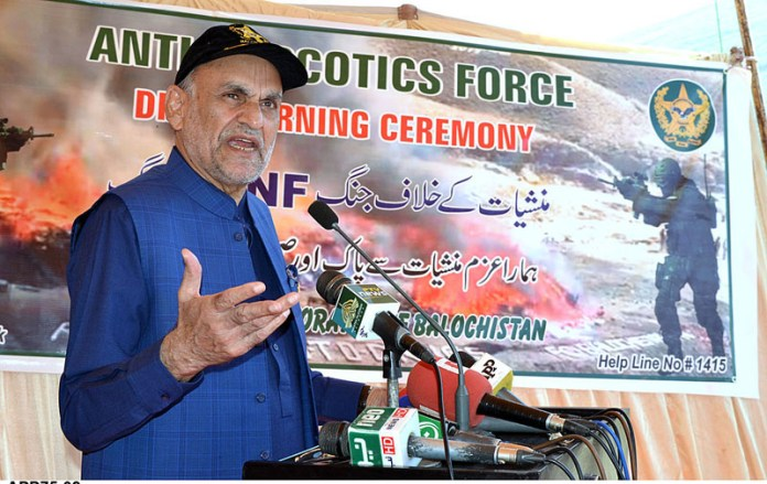 QUETTA: October 08 - Federal Minister for Narcotics Control, Senator Azam Khan Swati addressing at drug burning ceremony organized by Anti-Naroctic Force. APP photo by Mohsin Naseer