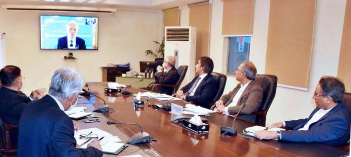 ISLAMABAD: October 22 - Adviser to the Prime Minister on Finance, Dr. Abdul Hafeez Shaikh in a virtual meeting with Managing Director World Bank, Mr. Axel Van Trotsenburg and Vice President SAR, World Bank, Mr. Hartwing Schafer. APP