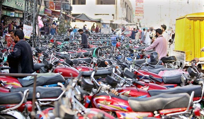 RAWALPINDI: November 05 - A view of parked motorcycles at a illegal parking at Imperial Market creating hurdles for smooth flow of traffic and needs the attention of the concerned authorities. APP photo by Abid Zia