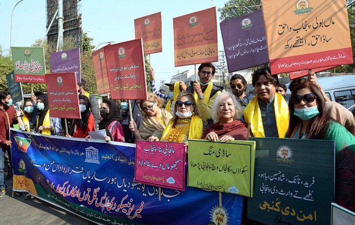 LAHORE: November 07 – People participating in a demonstrating for the promotion of Punjabi Education outside Press Club. APP Photo by Amir Khan