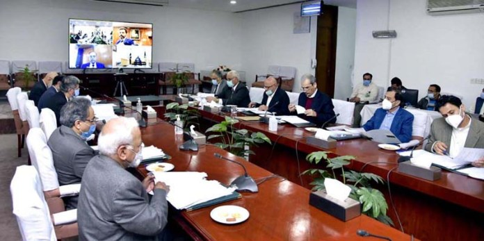 Adviser to the Prime Minister on Finance and Revenue, Dr. Abdul Hafeez Shaikh chairing a meeting of the Economic Coordination Committee (ECC) of the Cabinet