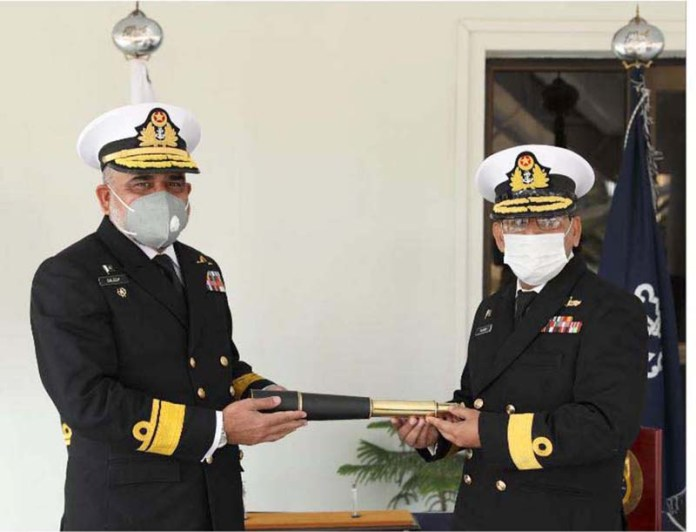 Rear Admiral Muhammad Saleem handing over the Command scroll of Commander North to Commodore Masood Khurshid during Change of Command ceremony